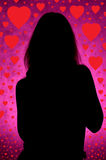 Girl silhouette with hearts Royalty Free Stock Photo