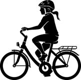 Girl silhouette on her bicycle Stock Photos