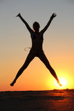 Girl silhouette jumping Royalty Free Stock Photography