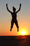 Girl silhouette jumping Royalty Free Stock Image