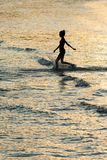 Girl silhouette in the sea Stock Images