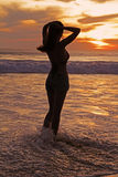 Girl. Silhouette of girl standing in the see water in the sunset Royalty Free Stock Photo