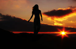 Girl silhouette on sunset Royalty Free Stock Photography