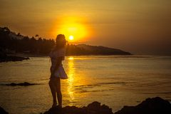 Girl silhouette on sunset beach background Stock Images