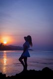 Girl silhouette on sunset beach background Stock Photography