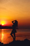 Girl silhouette on sunset beach background Royalty Free Stock Photography