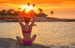 Girl silhouette at beach sunset heart shape royalty free stock images
