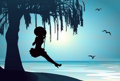 Girl silhouette on swing agains water lake Royalty Free Stock Images