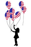 Girl silhouette with US patriotic balloons Stock Photography