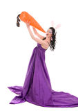 Girl in a silk dress, with rabbit ears and carrot Royalty Free Stock Photo