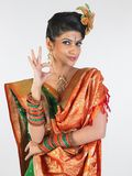 Girl in silk sari saying excellent Stock Image