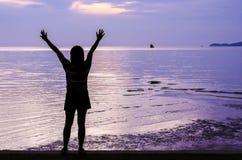 Girl siluet in violet sunset Stock Image