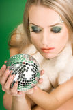 Girl with silver ball Royalty Free Stock Image