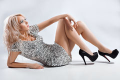 Girl in silver dress and shoes. Stock Images