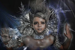 Girl in silver and foil Stock Images