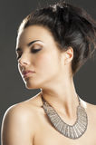 The girl with silver necklace, she looks at right Royalty Free Stock Image