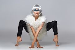 Girl in silver wig with blue makeup. Beautiful young woman in silver wig with blue makeup. beauty studio shot. copy space stock images