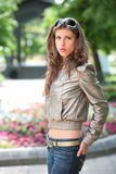 Girl in silvery jacket Royalty Free Stock Photography