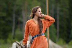 Girl in a simple retro orange dress Royalty Free Stock Image