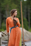 Girl in a simple retro orange dress Stock Images