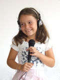 Girl sing. Girl with headphones and microphone Royalty Free Stock Photo