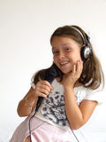 Girl sing. Girl with headphones and microphone Stock Image