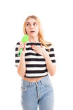 Girl sing song in hairbrush isolated. On white Royalty Free Stock Images