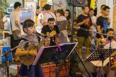A girl sing Thai song at old town night market. Is called Lard Yai in Phuket, Thailand Royalty Free Stock Photo
