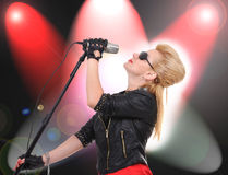 Girl singer. Beautiful rock girl singer with microphone stock images