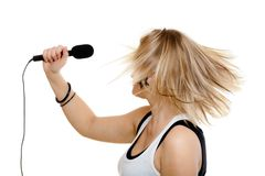 Girl singer singing to microphone isolated on whit Stock Photo
