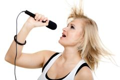 Girl singer singing to microphone isolated on whit Royalty Free Stock Images