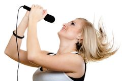 Girl singer singing to microphone isolated on white. Stock Photography