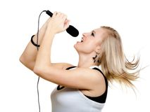 Girl singer singing to microphone isolated on white. Stock Images