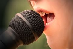 Girl singing 3 Stock Photos
