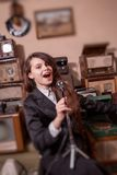 Girl singing in antique shop Stock Photography