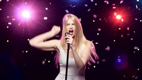 Girl singing and dancing with retro microphone strobe lighting effect.