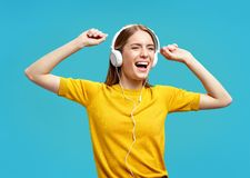 Girl singing and having fun while listening royalty free stock image