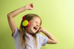 Girl singing in headphones, 3D anaglyph effect. Little girl singing in yellow headphones. 3D anaglyph effect photo stock photos