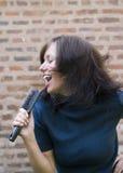 Girl singing on her hair brush Stock Photos