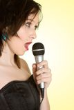 Girl Singing Karaoke Stock Image