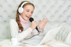 Girl singing karaoke Stock Photography