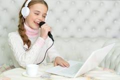Girl singing karaoke Stock Images