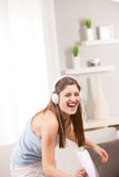 Girl singing and laughing in her living room Stock Photography