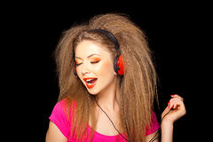 Girl singing while listening music on headphones Royalty Free Stock Photo