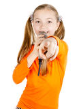 Girl singing into a microphone stock photography