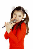Girl singing into a microphone stock photos