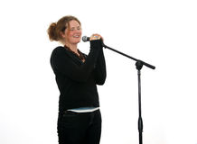 Girl singing with microphone royalty free stock photo
