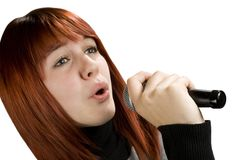 Girl singing on microphone stock images