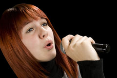 Girl singing on microphone Royalty Free Stock Photography