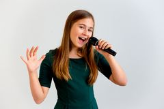 Girl singing with a microphone royalty free stock images